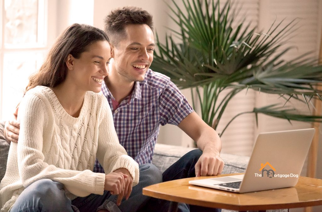 Couple checking remortgage deals