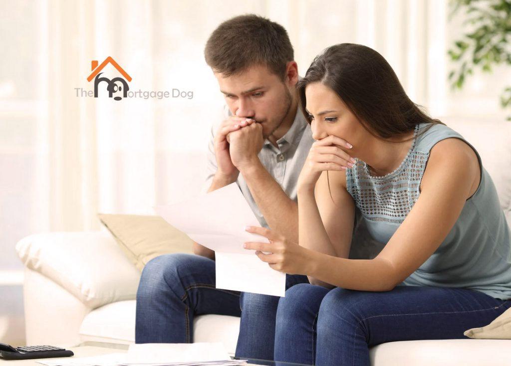 Couple check mortgage payment holiday paperwork