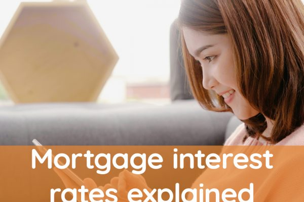 Woman looking at mortgage interest rates
